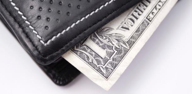 Dinheiro, carteira, dólar - Thinkstock
