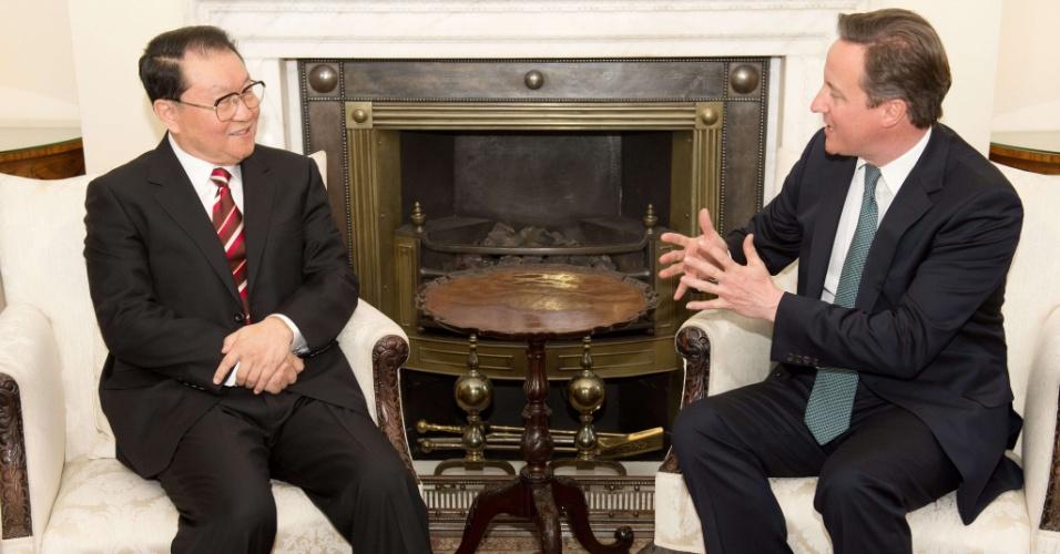 Li Changchun, principal representante do Partido Comunista chinês, e o primeiro-ministro do Reino Unido, David Cameron, reuniram-se em Downing Street, em Londres