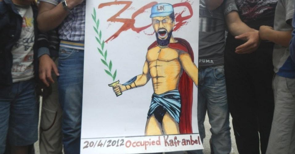 Manifestantes seguram cartaz inspirado no filme 300 durante protesto pelo impeachment do presidente da Síria, Bashar al-Assad, na região de Kafranbel