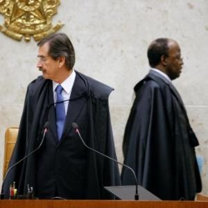 Os ministros do STF Cezar Peluso (esq.) e Joaquim Barbosa (dir.) - Sergio Lima/Folhapress