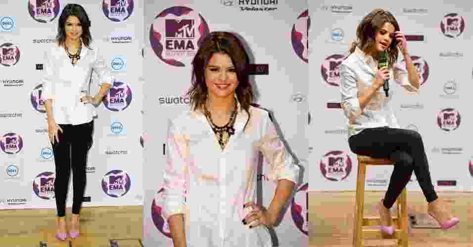 Calças skinny (bem justinhas no corpo) e blusas soltinhas formam o conjunto favorito de Selena Gomez em seus looks casuais. Para ir ao MTV Europe Music Awards, ela optou por peças básicas, como a calça preta e a camisa branca, com assessórios chamativos, como o scarpin rosa e o maxi colar (05/11/2011) - Getty Images