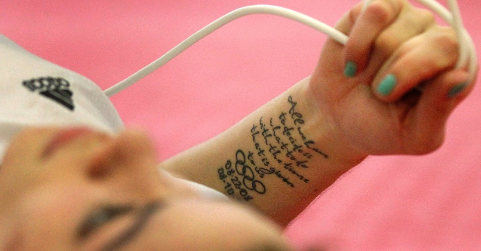 Tatuagem de Karine Sergerie, canadense do taekwondo, relembrando a data da cerimônia de abertura dos Jogos Olímpicos de 2008