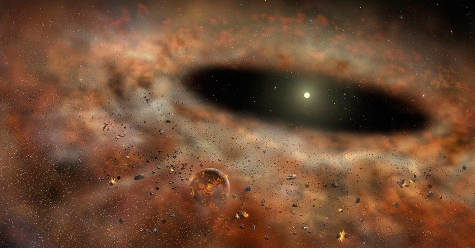 4.jul.2012 - A concepção artística, cedida pelo Observatório Gemini, mostra o empoeirado TYC 8241 2652 emitindo grandes quantidades de radiação infravermelha. O disco brilhante de poeira ao redor de uma estrela semelhante ao Sol desapareceu de repente e os cientistas ainda analisam o motivo. A descoberta poderá fazer com que os astrônomos repensem o que acontece durante a formação de um sistema solar