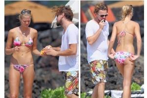 O ator americano Leonardo Di Caprio é fotografado ao lado da modelo Erin Heatherton em praia americana