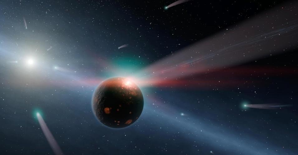 23.jul.2012 - A concepção artística ilustra uma tempestade de cometas em torno da estrela Eta Corvi. A descoberta foi feita pelo telescópio Spitzer da Nasa (agência espacial americana) que detectou ingredientes fundamentais para os cometas, como gelo, compostos orgânicos e rocha ao redor da estrela