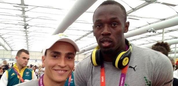 Cesar Castro, brasileiro dos saltos ornamentais, posa para foto com o velocista jamaicano Usain Bolt