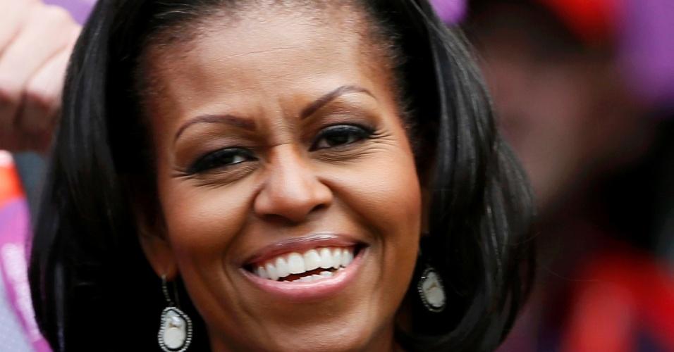 Primeira-dama dos Estados Unidos, Michelle Obama, acompanha o jogo entre Serena Williams e Jelena Jankovic pela primeira rodada do tênis olímpico (28/07/2012)