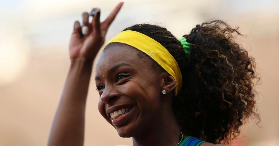 Rosângela Santos, atleta do Brasil, comemora segunda colocaçao na primeira eliminatória dos 100 m rasos