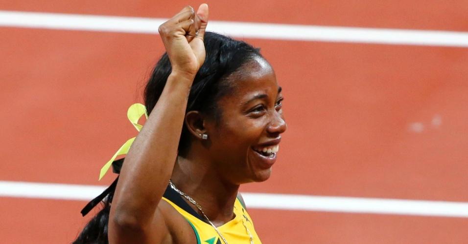 Jamaicana Shelley-Ann Fraser-Pryce comemora após conquistar ouro na prova dos 100 m livres