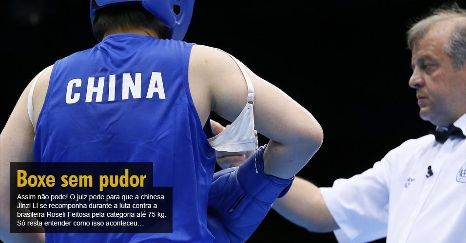Assim não pode! O juiz pede para que a chinesa Jinzi Li se recomponha durante a luta contra a brasileira Roseli Feitosa pela categoria até 75 kg. Só resta entender como isso aconteceu?
