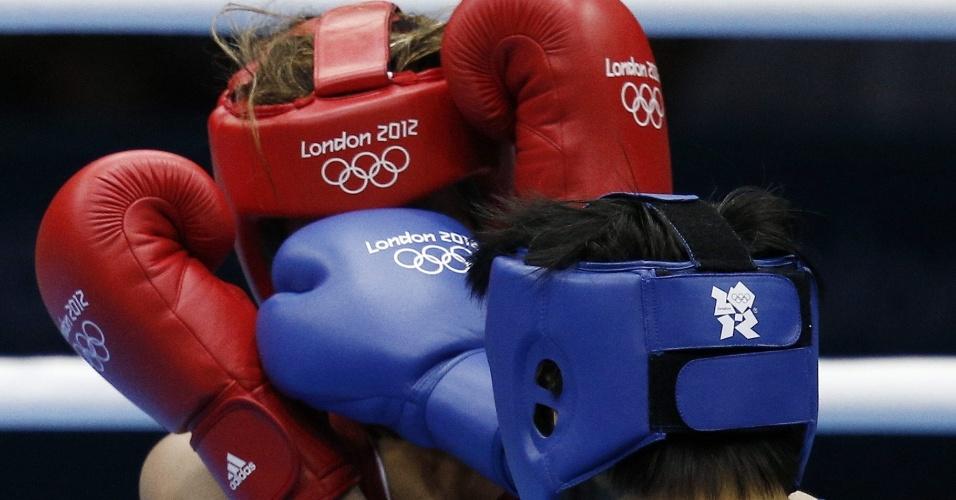 Chinesa fura a guarda de Roseli Feitosa e acerta a brasileira, que foi eliminada na estreia do boxe feminino em Olimpíadas