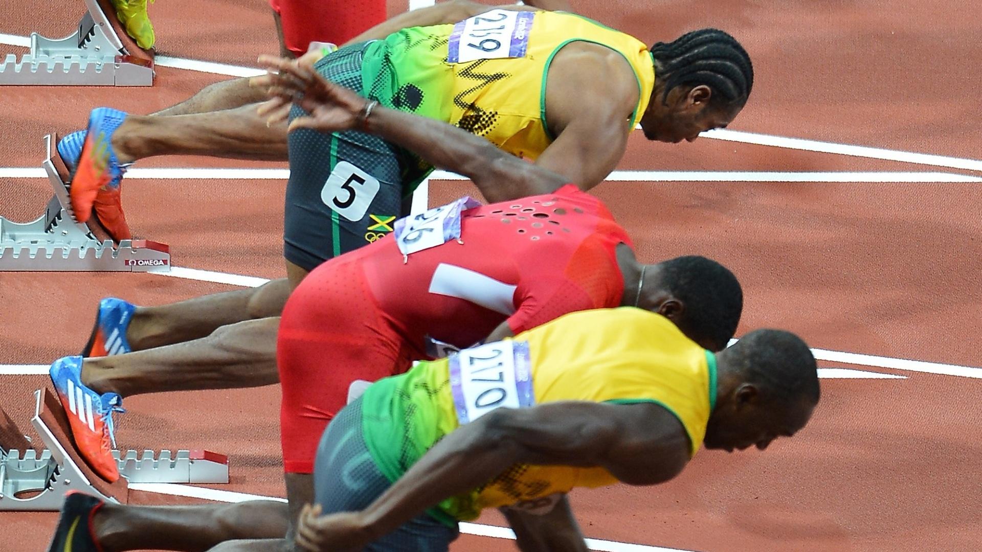 De baixo para cima, favoritos Usain Bolt, Justin Gatlin e Yohan Blake largam na final olímpica dos 100 m rasos