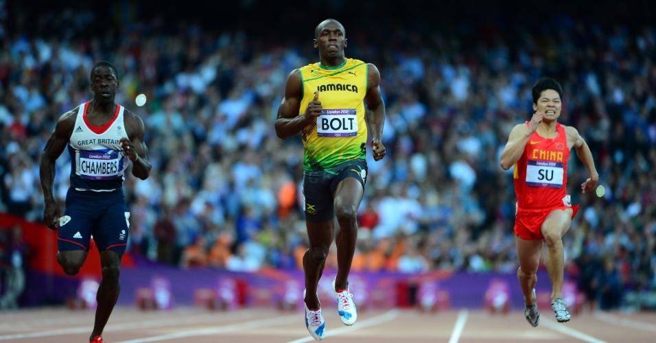 Jamaicano Usain Bolt (c) disputa a semifinal dos 100 m rasos entre o britânico Dwain Chambers (e) e o chinês Su Bingtian