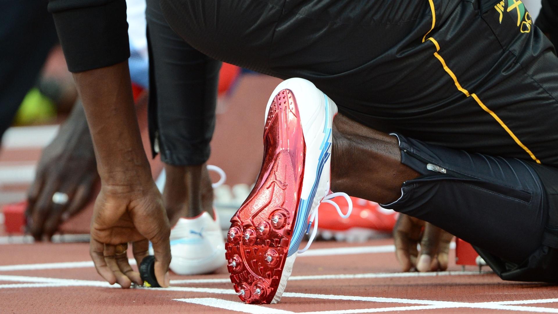 Jamaicano Usain Bolt prepara-se para correr em série semifinal dos 100 m rasos
