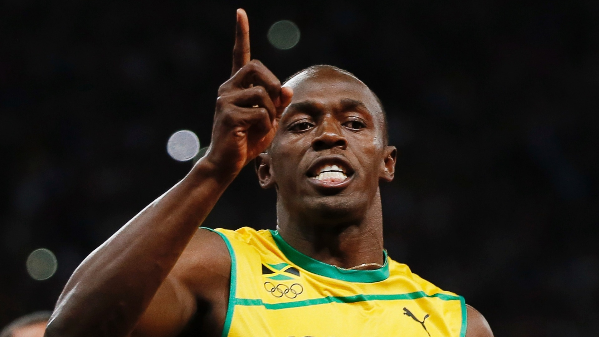 Usain Bolt comemora o ouro nos 100 m rasos em Londres-2012