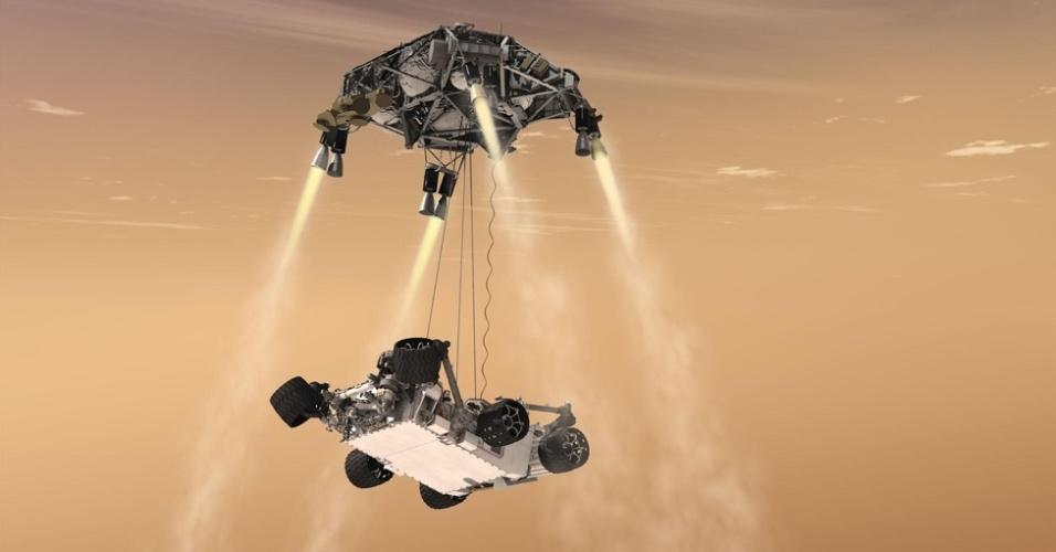 6.ago.2012 - Na foto, uma simulação de como foi o pouso do 'Curiosity' em Marte. Uma espaçonave amorteceu a decida do jipe-robô ao solo marciano