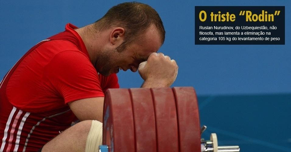 Ruslan Nurudinov, do Uzbequiestão, não filosofa, mas lamenta a eliminação na categoria 105 kg do levantamento de peso