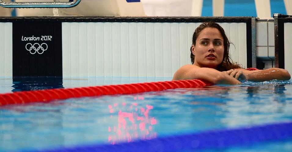 Zsuzsanna Jakabos aguarda anúncio de seu tempo após competir na prova dos 200 m borboleta