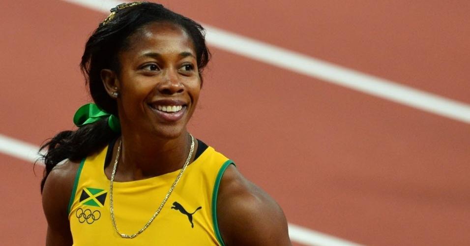 Shelly-Ann Fraser-Pryce, da Jamaica, sorri após semifinal dos 200 m rasos no Estádio Olímpico de Londres