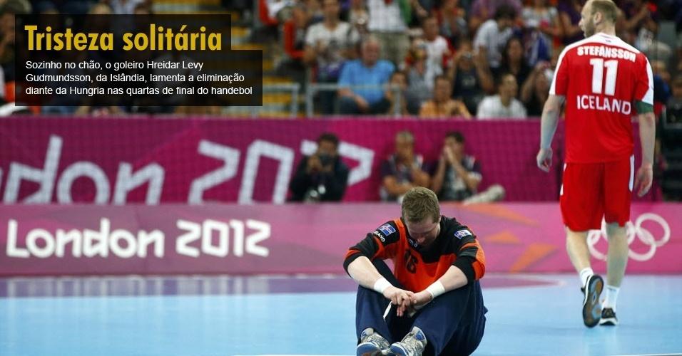 Sozinho no chão, o goleiro Hreidar Levy Gudmundsson, da Islândia, lamenta a eliminação diante da Hungria nas quartas de final do handebol