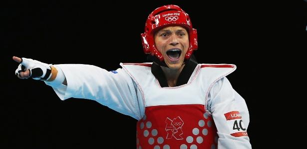 Neozelandês Logan Campbell reclama durante derrota pára ucraniano Hryorii Husarov no taekwondo