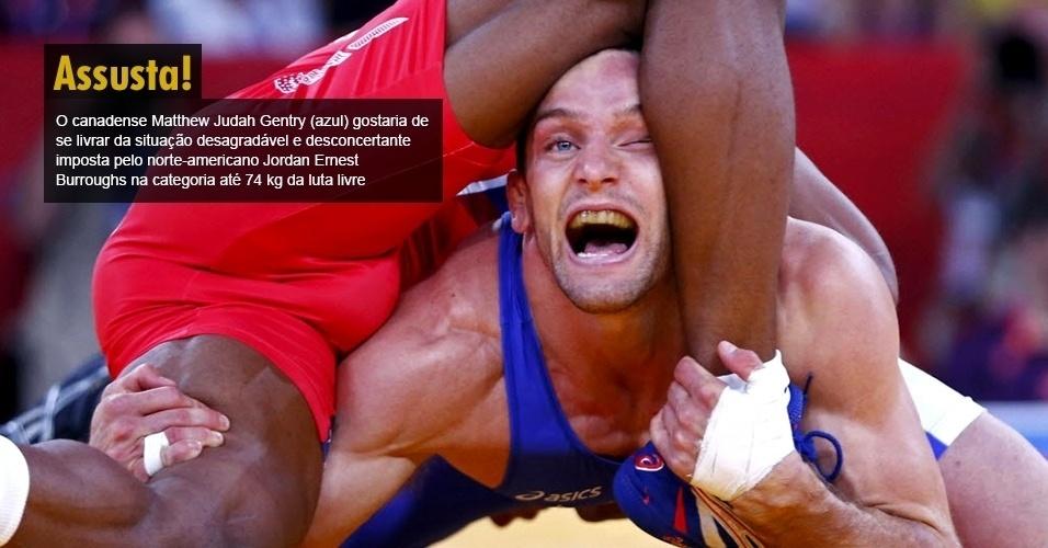O canadense Matthew Judah Gentry (azul) gostaria de se livrar da situação desagradável e desconcertante imposta pelo norte-americano Jordan Ernest Burroughs na categoria até 74 kg da luta livre