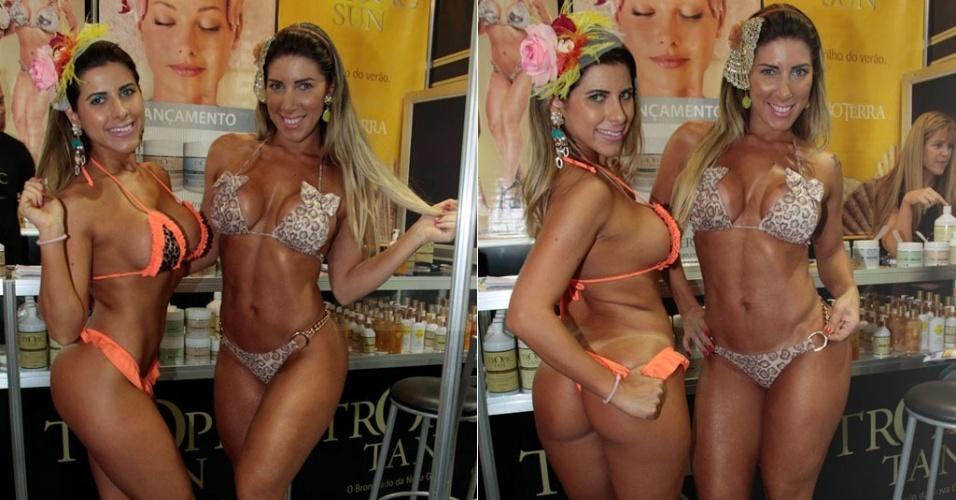 De biquíni, Ana Paula e Tatiane Minerato posam para fotos durante feira de beleza em São Paulo (11/9/12)