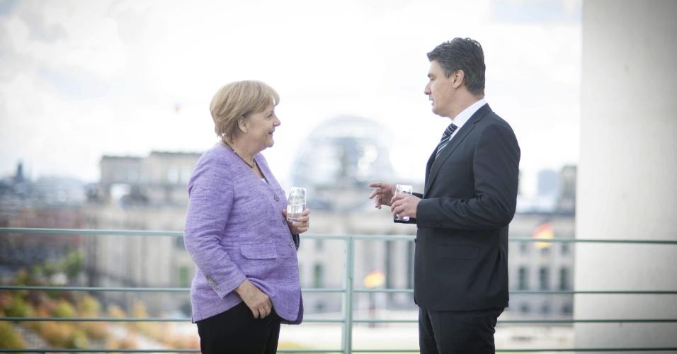19.set.2012 - A chanceler alemã, Angela Merkel, encontra o premiê croata, Zoran Milanovic, em Berlim, na Alemanha