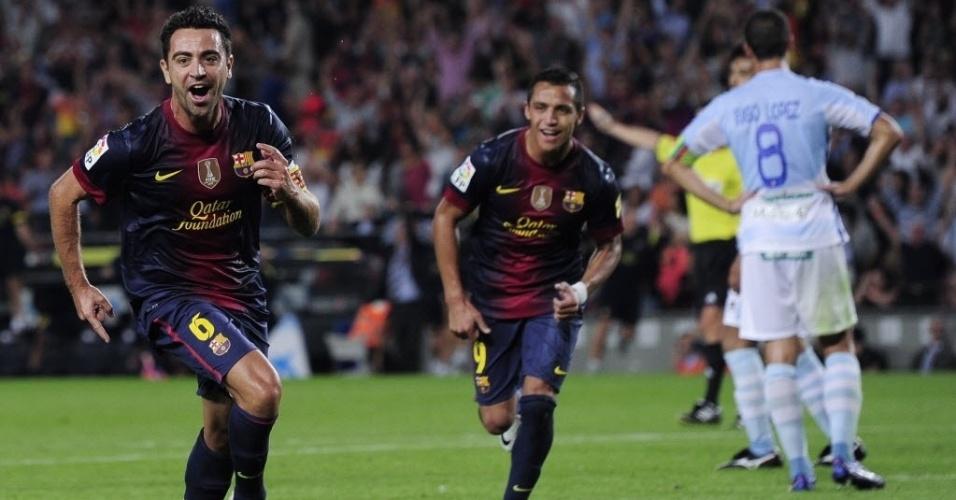Xavi comemora gol marcado na vitória do Barcelona por 2 a 0 sobre o Granada