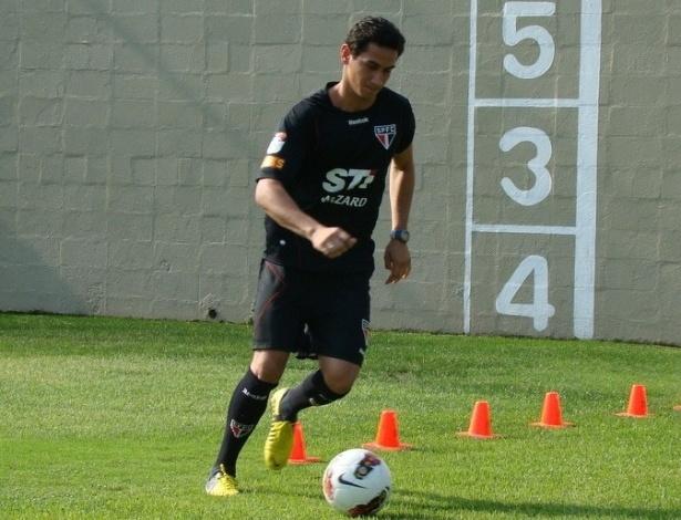 Ganso corre com a bola e treina em separado após aquecimento com o grupo do São Paulo (29/10/2012)