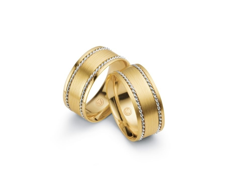 Par de alianças Honeymoon (de ouro amarelo e com detalhes de ouro branco) da joalheria Vivara (www.vivara.com.br)