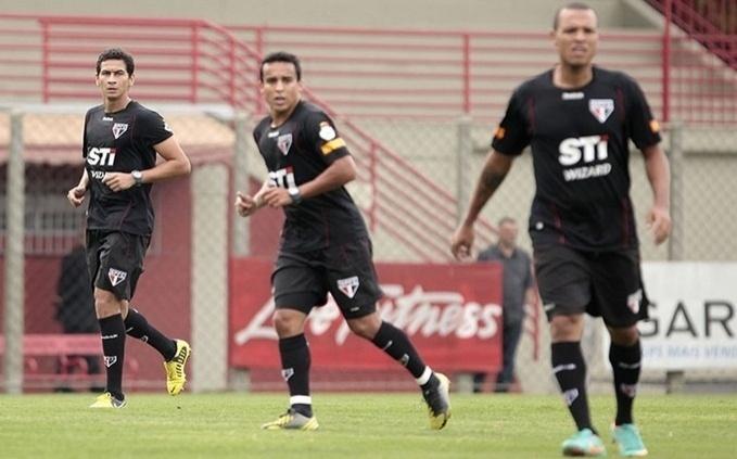 Ganso e Jadson durante jogo-treino contra o Guarani nesta quinta-feira