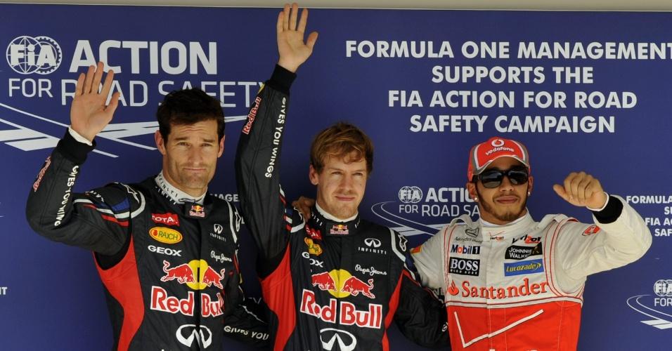 Mark Webber (e.), Sebastian Vettel e Lewis Hamilton (d.) posam para foto após conseguirem os três melhores tempos no treino classificatório para o GP do Texas neste sábado (17/11/2012)