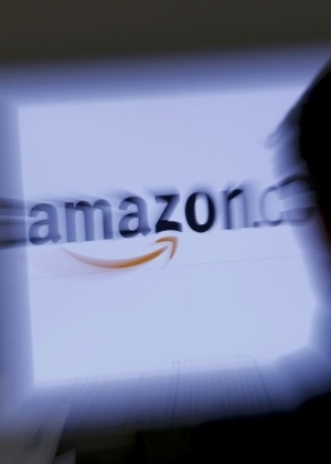 Logotipo da loja eletrônica Amazon - Leonhard Foeger/Reuters e Kimihiro Hoshino/AFP