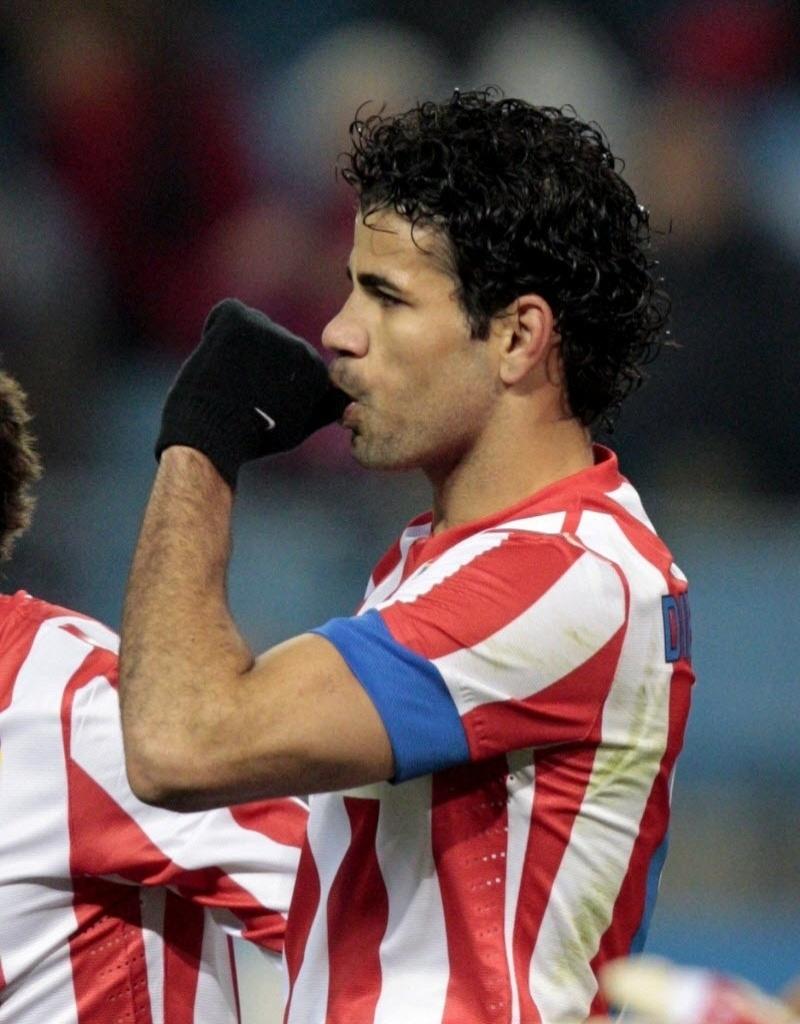 12.dez.2012 - Diego Costa, atacante brasileiro do Atlético de Madri, comemora depois de marcar na partida contra o Getafe, pelas oitavas de final da Copa do Rei