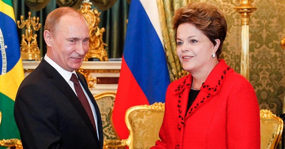14.dez.2012 - O presidente da Rússia, Vladimir Putin, recebe a presidente Dilma Rousseff durante encontro no Kremlin, em Moscou
