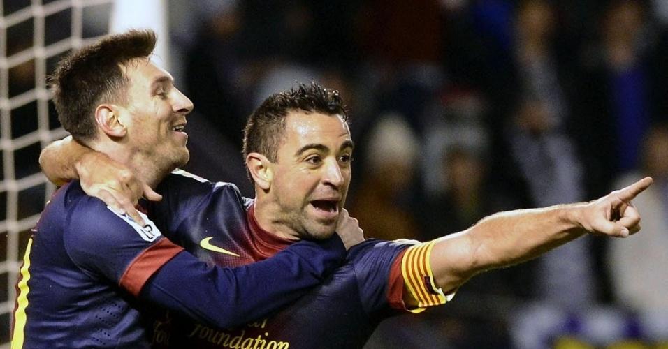 22/12/2012 - Xavi comemora com Messi o primeiro gol do Barcelona na vitória de 3 a 1 sobre o Valladolid