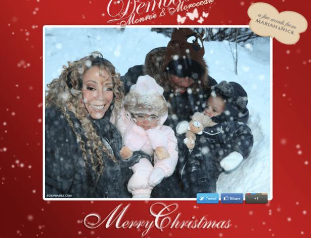 27.dez.2012 - A cantora Mariah Carey tira foto com os gêmeos Moroccan e Monroe e seu marido Nick Cannon. A família se diverte durante a neve