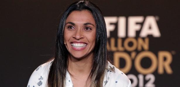 Marta sorri durante coletiva de imprensa antes da premiação Bola de Ouro da Fifa - Christof Koepsel/Getty Images