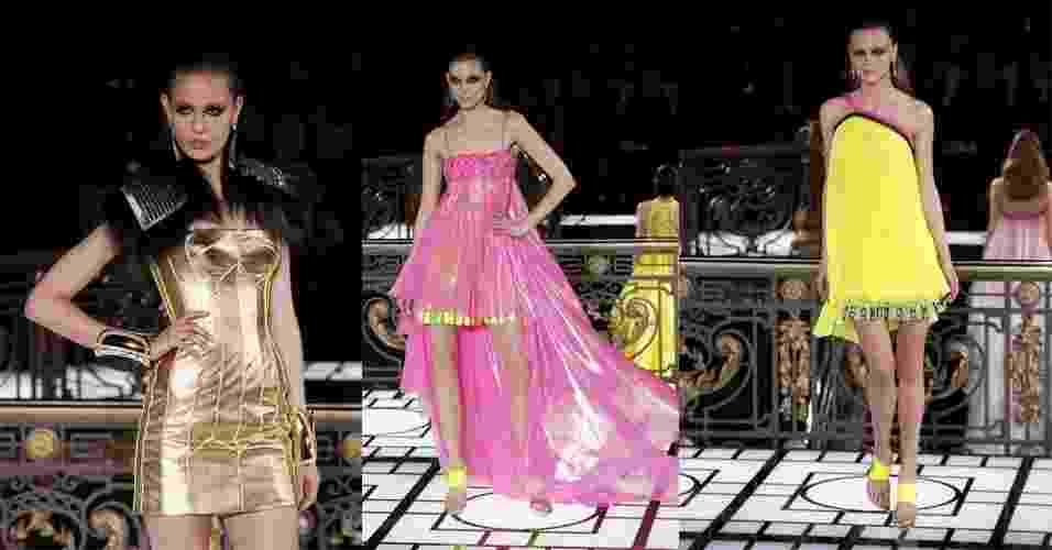 21.jan.2013 - A Atelier Versace abriu a temporada de Verão 2013 da semana de alta-costura em Paris com uma coleção extravagante que misturava cores neon com metalizados. Os vestidos sensuais, fendas e recortes vazados característicos da marca não faltaram na passarela - AFP