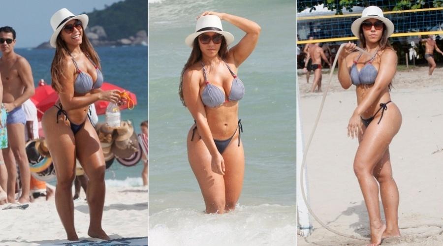 25.jan.2013 - Renata Frisson, a Mulher Melão, curtiu a praia da Barra da Tijuca, zona oeste do Rio