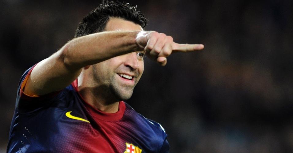 28.jan.2013 - Xavi renovou com o Barcelona