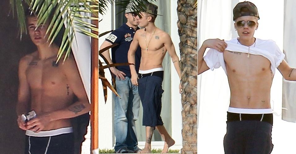 28.jan.2013 - Justin Bieber levanta a camisa para mostrar o abdômen em Miami