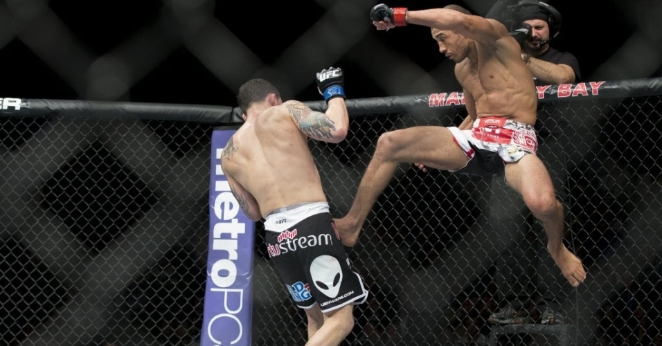 José Aldo acerta belo chute em Frankie Edgar durante luta no UFC 156