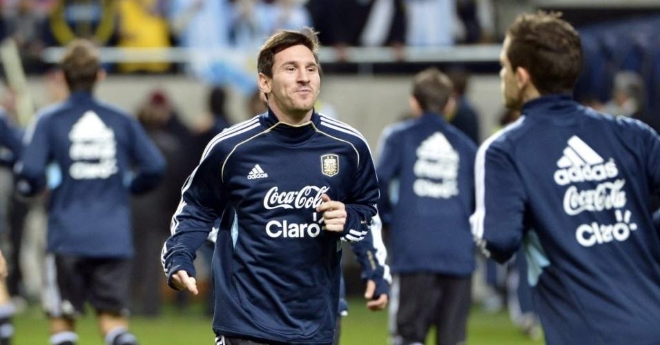 06.fev.2013 - Lionel Messi faz aquecimento antes do amistoso entre Argentina e Suécia, na capital sueca Estocolmo