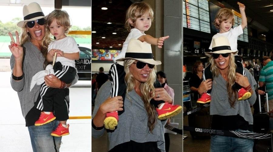 8.fev.2013 - Adriane Galisteu é fotografada com o filho antes de embarcar para o Uruguai