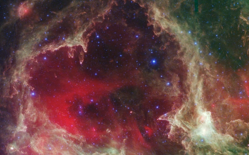14.fev.2013 - Neste dia 14 de fevereiro é comemorado o dia de São Valentim, e o Dia dos Namorados em vários países do mundo. Em homenagem à data, a Nasa (Agência Espacial Norte-Americana) divulgou esta imagem que parece um coração de uma região de formação de estrelas capturada pela luz infravermelha do telescópio Spitzer