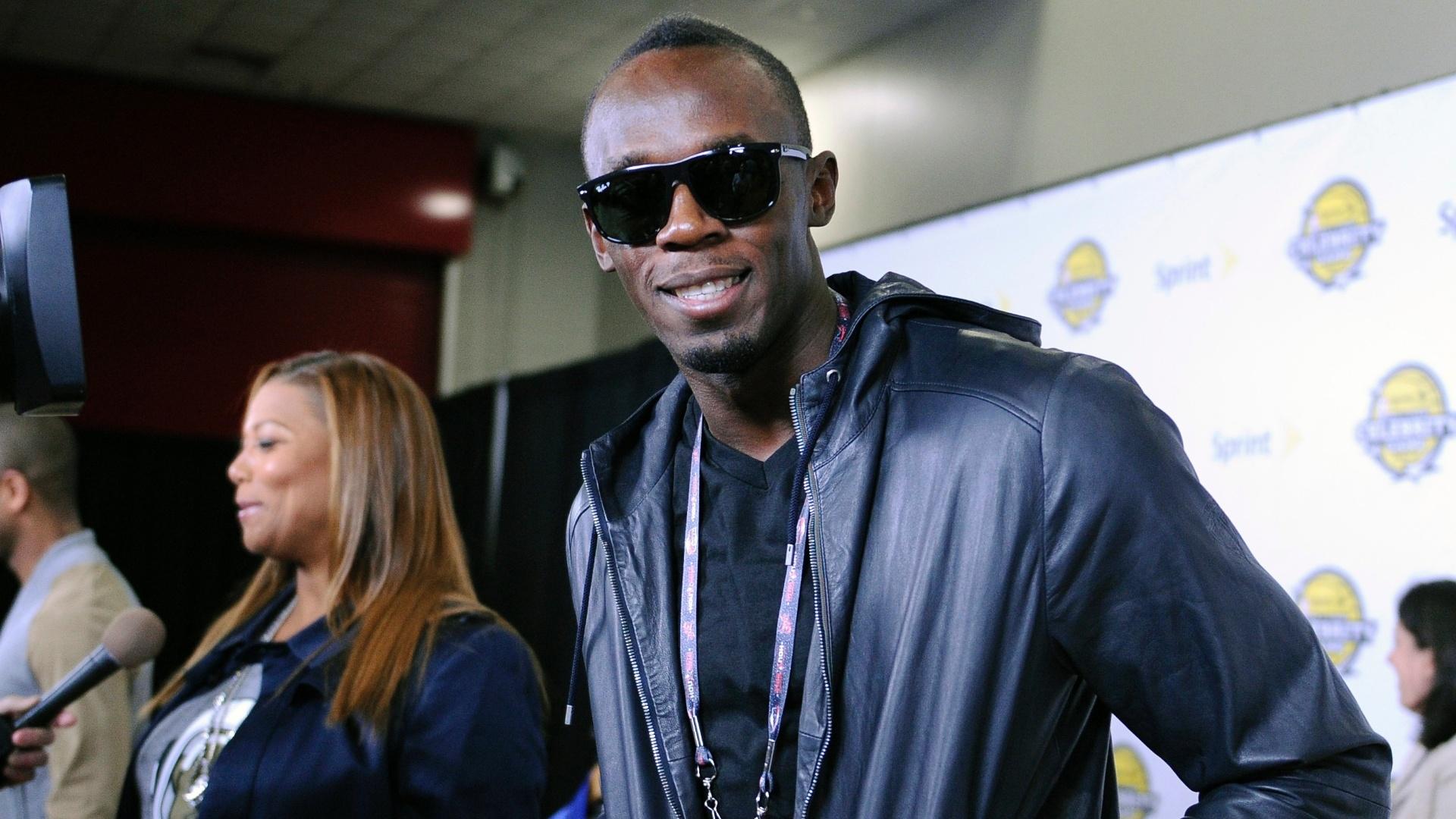 15.fev.2013 - Campeão olímpico, jamaicano Usain Bolt chega ao jogo das celebridades do All-Star Game, tradição da NBA