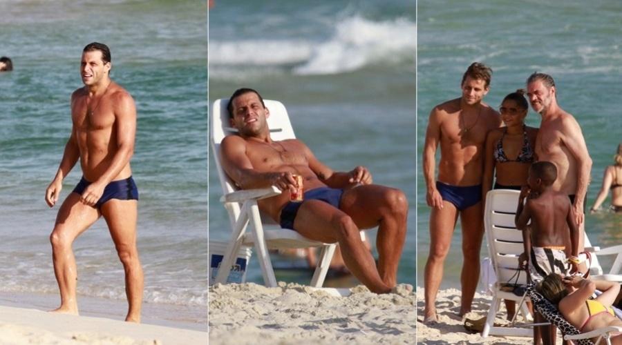 18.fev.2013 - Henri Castelli curtiu praia na Barra da Tijuca, zona oeste do Rio. O ator foi tietado por fãs. Henri está na novela