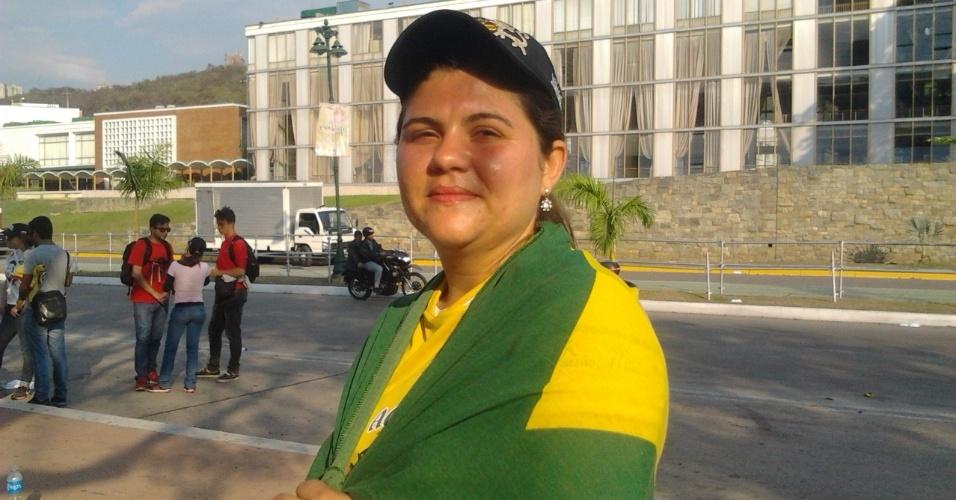 9.mar.13 - A brasileira Vaubéria Temótio Macedo, 27, estudante de medicina em Caracas, pôde ver o presidente Hugo Chávez em quatro oportunidades